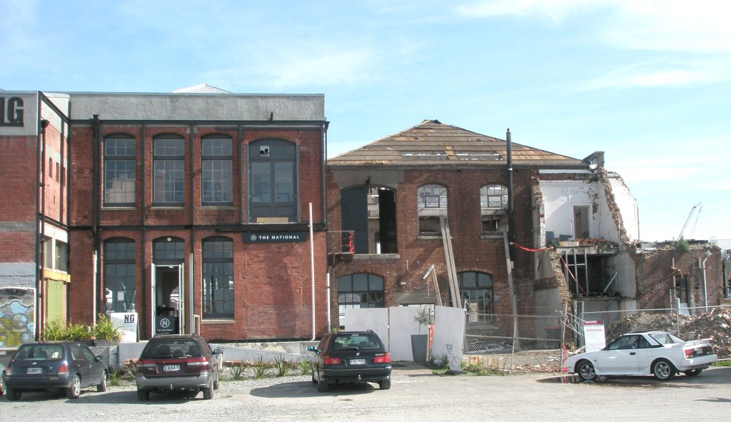 The National, on the left. Earthquake-damaged buildings on the right