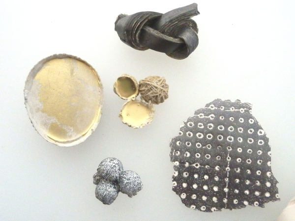 Plaster, resin, graphite, iron powder, golden powder